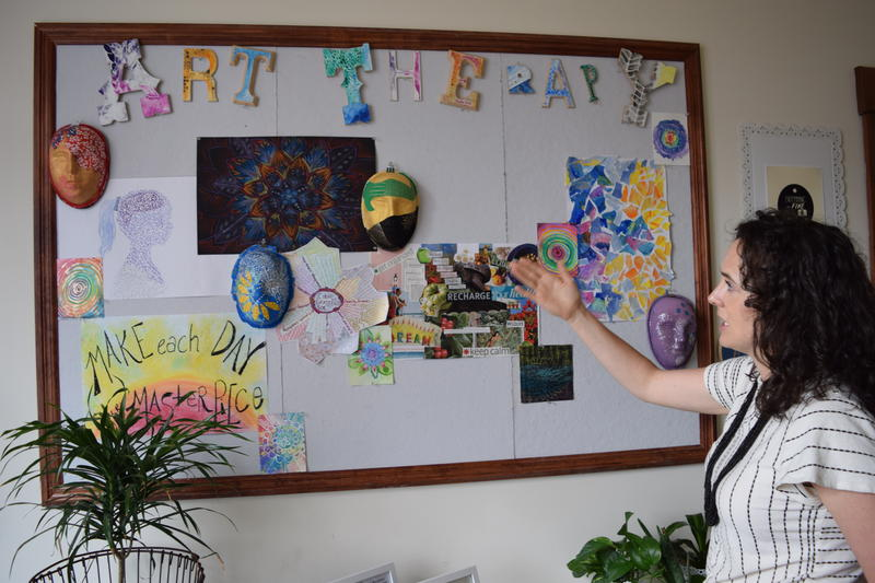 Art therapist Caitlin Walsh displays works she has created to help inspire her clients.