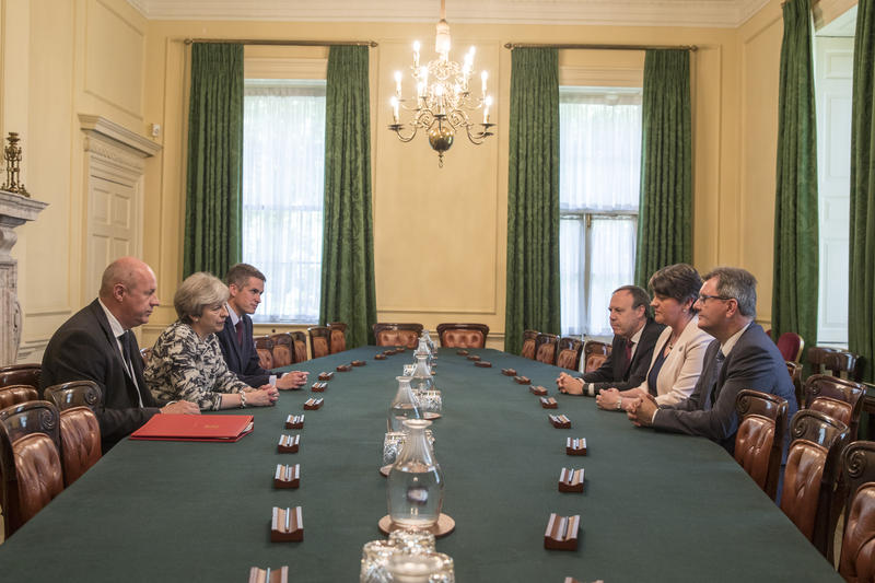 Prime Minister Theresa May's Conservatives signed a deal Monday with Northern Ireland's Democratic Unionist Party that will allow them to govern after losing their majority in a general election this month.