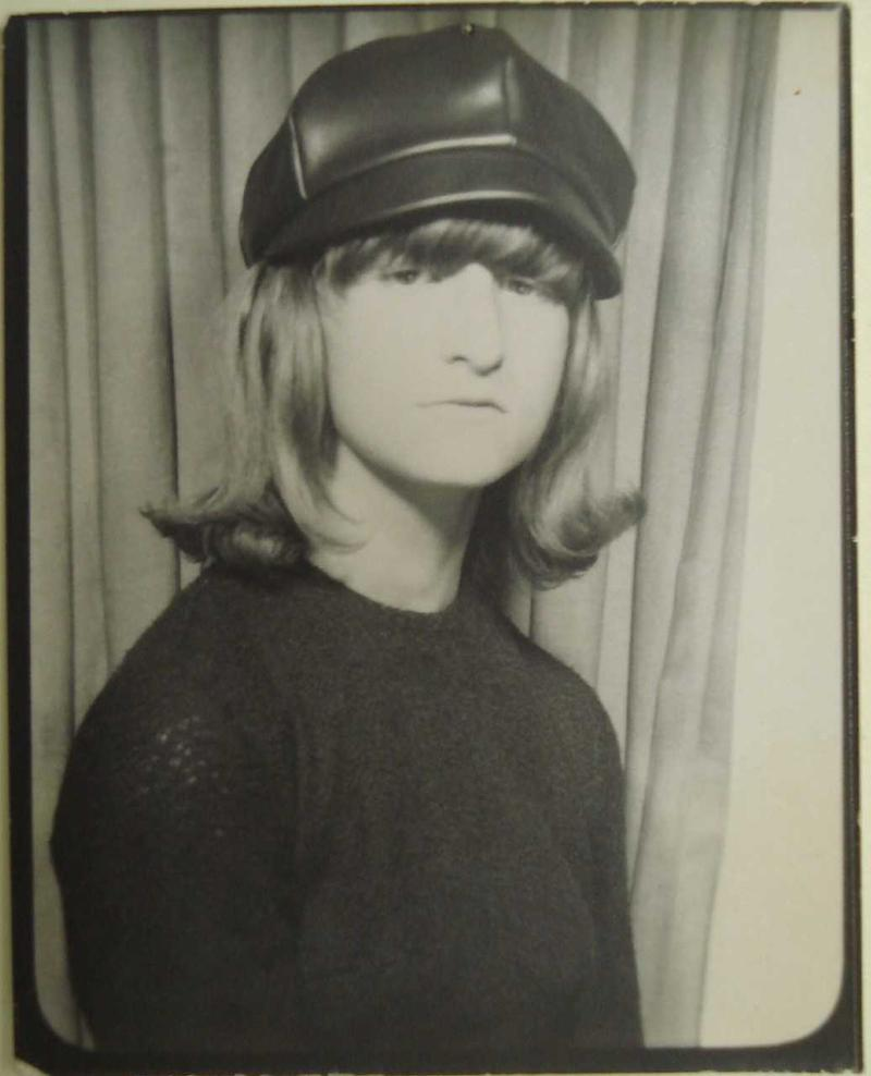 """1964 """"self portrait"""" Lou Sullivan took in a photo booth while wearing a Beatles-style hat."""