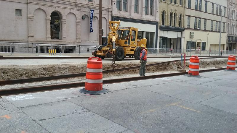 Workers lay tracks on Broadway.