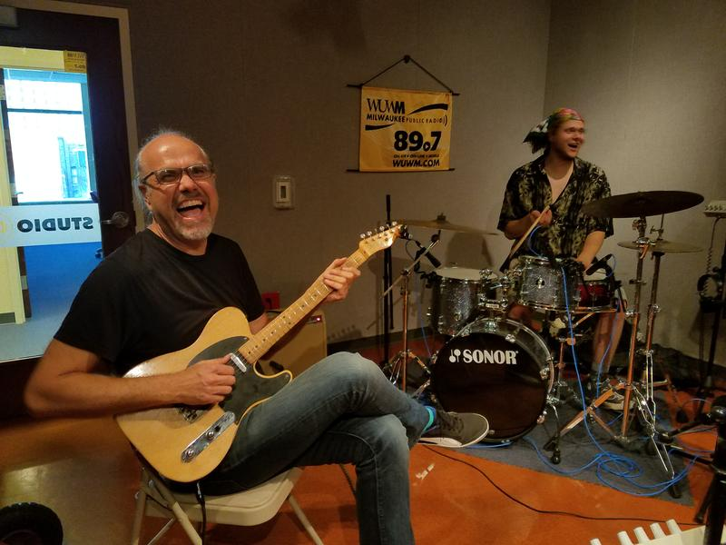Greg Koch laughs as he warms up with his son Dylan Koch in the Lake Effect studios. The two are part of the Koch Marshall Trio, which visited Lake Effect on Tuesday, July 18, 2017.