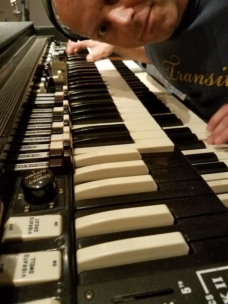 Toby Lee Marshall peeks down the keyboard of his Hammond B3 organ in the Lake Effect studio.