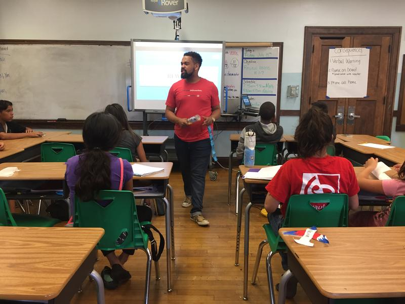 New TFA Milwaukee corps member Reginald Kirby runs through a review activity during summer school at MPS' Greenfield Bilingual School.