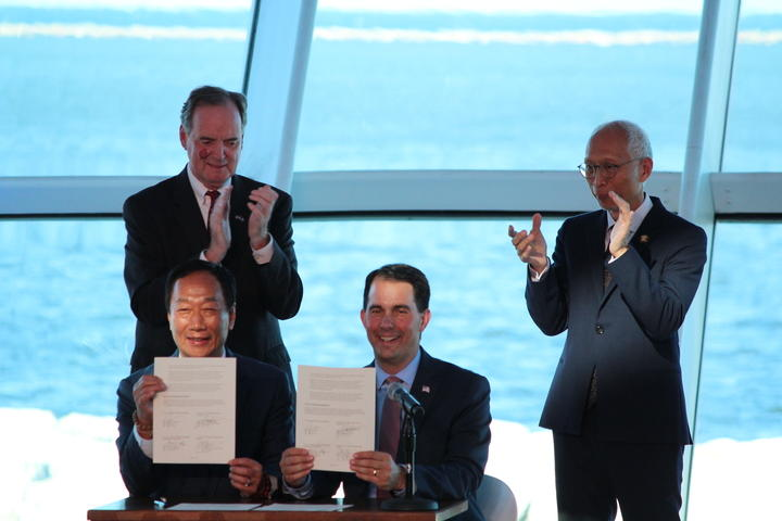 Governor Walker (seated right) with Foxconn executives at Milwaukee Art Museum last week.