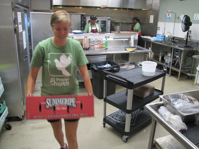 Hannah Uitenbroek heading out of All Peoples kitchen where  Ted Ellis and Tiffany Nash have been preparing breakfast.