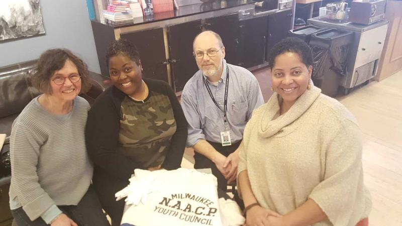 L-R: Peg Rozga, LeeSa McGhee Nelson (donor), David Driscoll, and Tanika Apaloo. Taken shortly before Leesa donated the shirt.