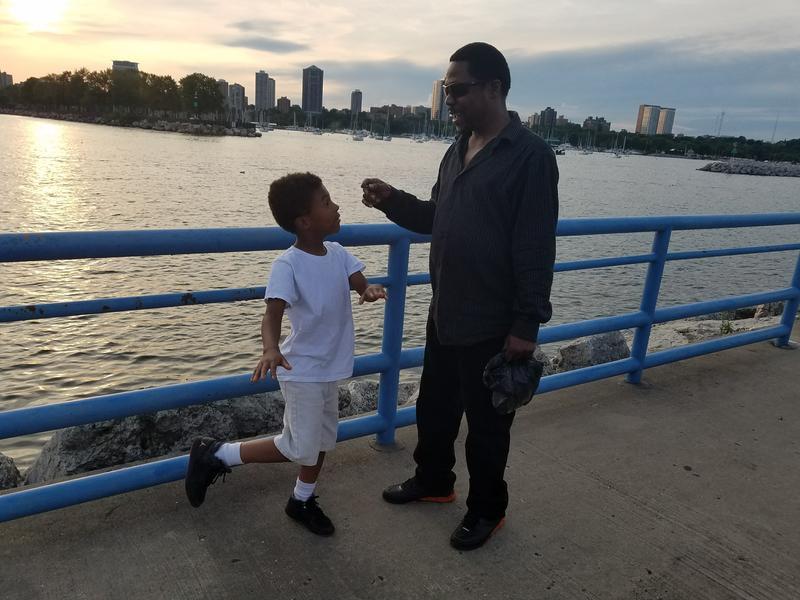 Keveon Pickett (L) and his dad Kelvin Thompson joke around on the breakwater