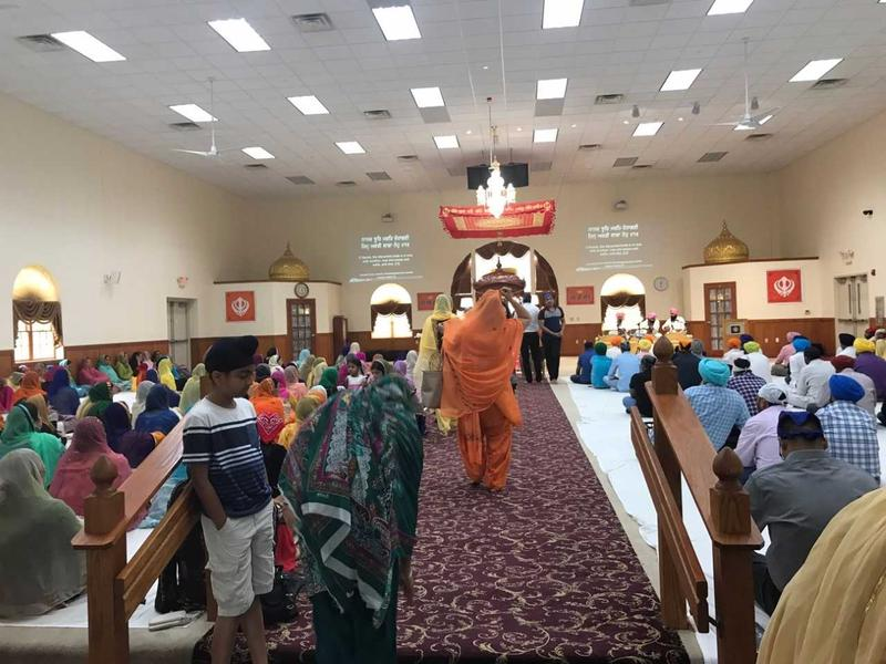 Inside the prayer hall of the temple on a Sunday morning around 11 a.m.