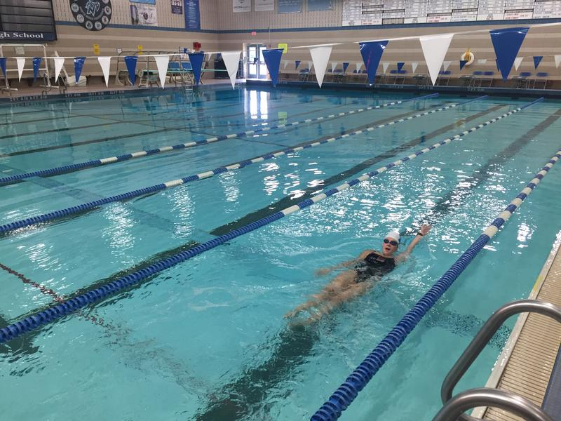 Nicolet High School senior Elizabeth Sullivan demonstrates how she counts strokes for her races.