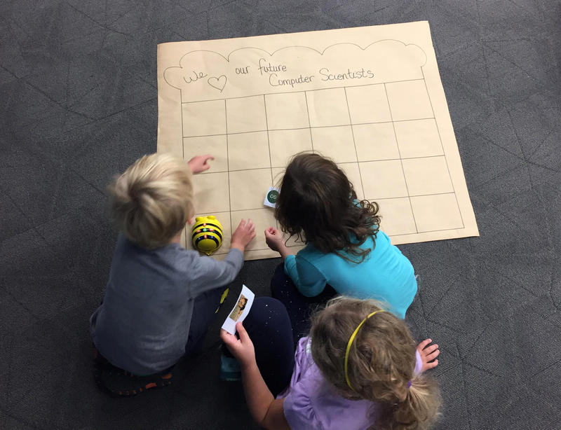 "First grade students at MJDS work together to program a robot. Every class at the school spends time in the building's ""Innovation Hub"" during the week."