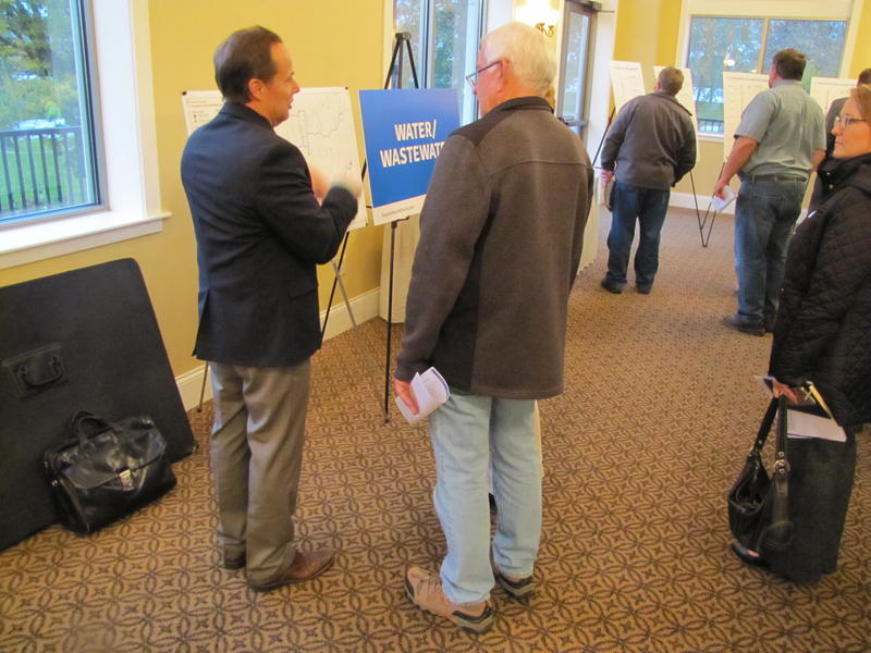 Tom Ludwig (left) with Foth Infrastructure & Environment was on hand to explain Foxconn's water and wastewater plans.