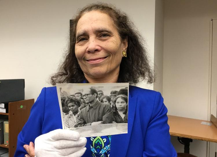 Daphne Barbee-Wooten holds a photo of her father, Lloyd Barbee, at the Wisconsin Historical Society Archives.