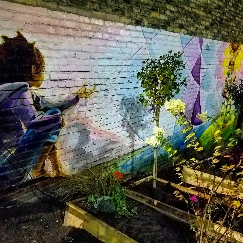 A garden planted by Tia Richardson's mural in 'Black Cat Alley,' on Milwaukee's east side
