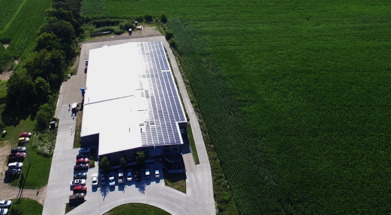 Solar panels line the roof of Cal Couillard's business, Componex.