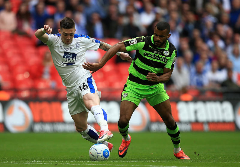 Jack Dunn of Tranmere holds off pressure from Daniel Wishart of Forest Green during the Vanarama National League Play Off Final.