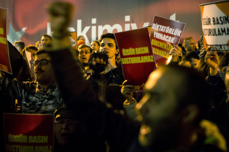 ISTANBUL, TURKEY - OCTOBER 31: People protest outside the Cumhuriyet Newspaper office after thirteen journalists including the editor-in chief were arrested on October 31, 2016 in Istanbul, Turkey.