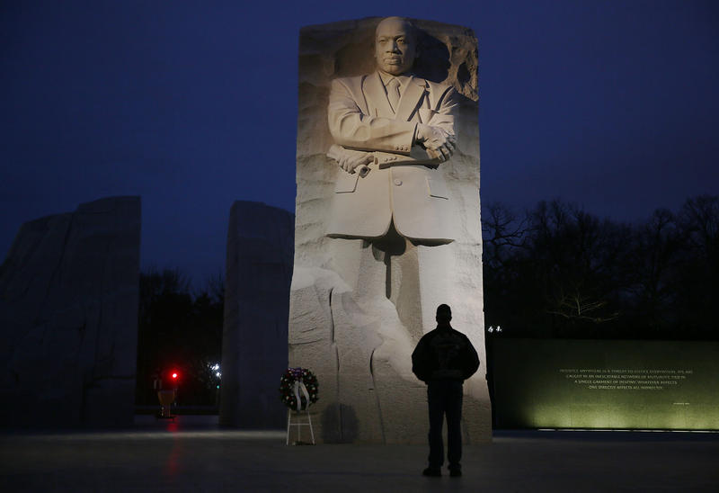 A man visits the Martin Luther King Jr. memorial on the day that honors him on January 16, 2017 in Washington, DC.