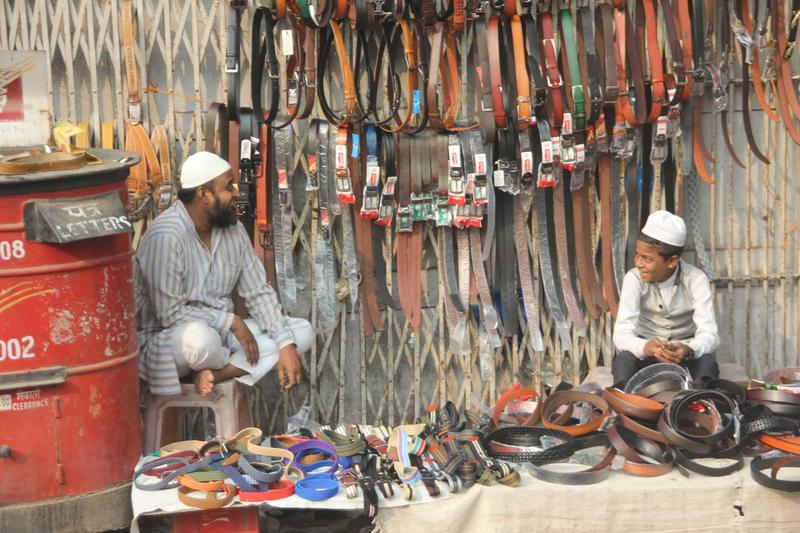 A smile from a belt seller in Old Delhi.