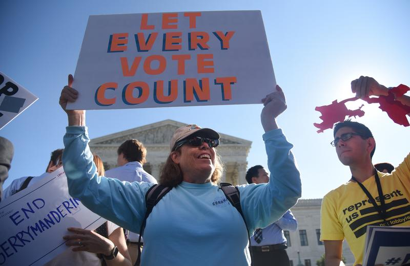 Demonstrators gather outside of The United States Supreme Court during an oral arguments in Gill v. Whitford to call for an end to partisan gerrymandering on October 3, 2017 in Washington, DC.