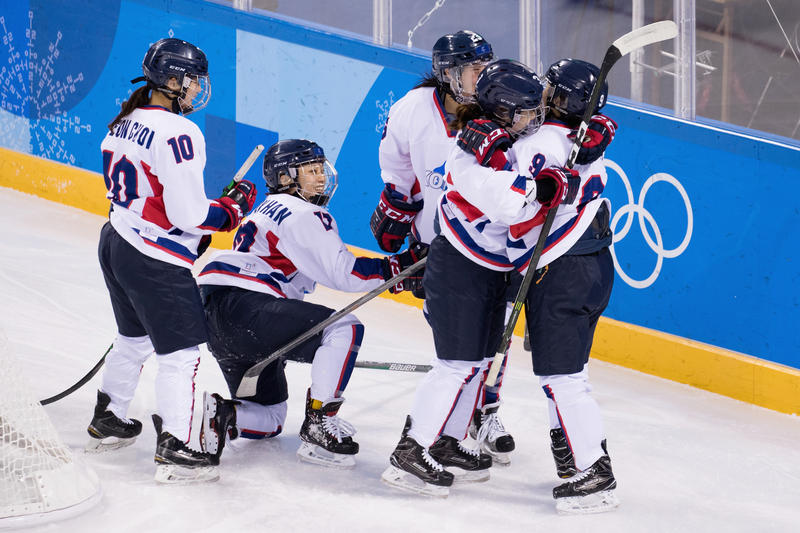 Korean team mates celebrate after scoring a goal in the first period against Sweden during the Women's Classifications game on day eleven of the Winter Olympic Games at Kwandong Hockey Centre on February 20, 2018 in Gangneung, South Korea.