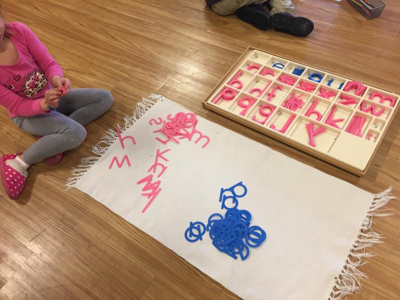 "A primary school student works on her spelling using ""movable alphabet"" materials at Nature's Classroom Montessori School."