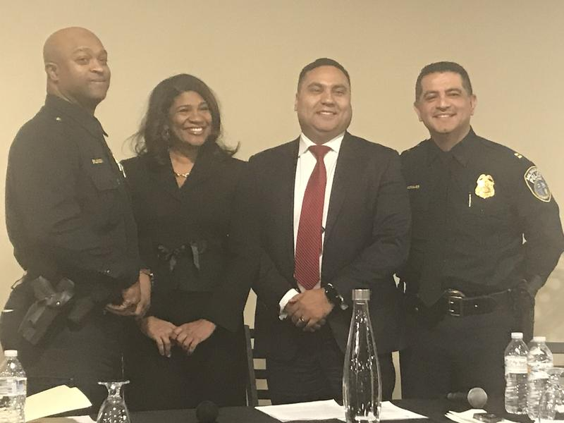 Inspector Michael Brunson (L) and Captain Alfonso Morales (R) pose with event moderators Donsia Strong Hill and Gene Manzanet.