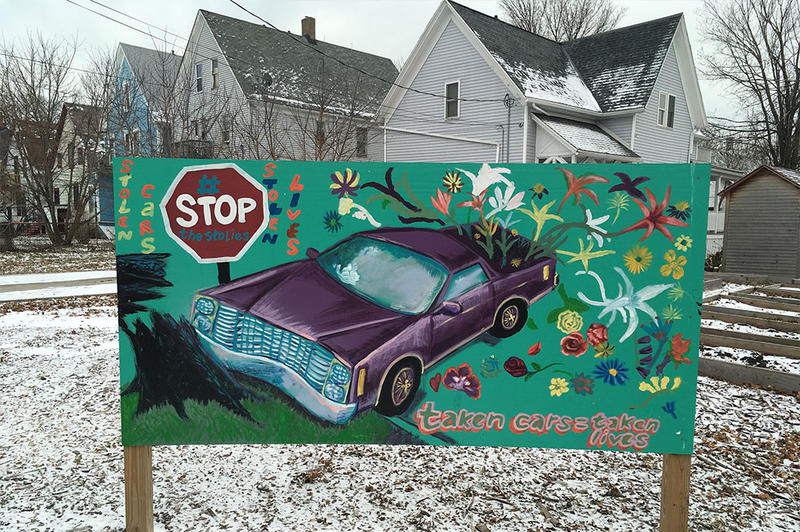 Artwork in Lindsay Heights warns passersby of the dangers of car theft and joyriding.