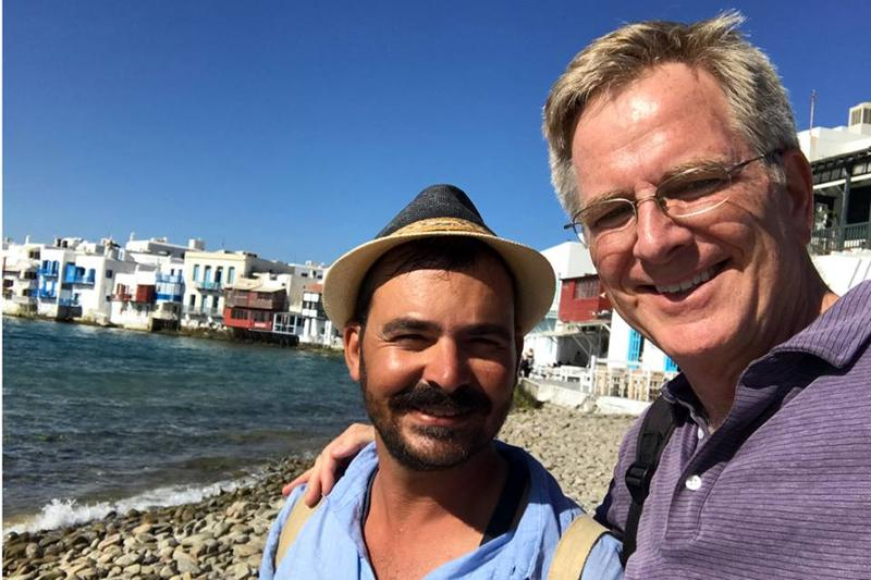 Rick Steves with a Mykonos guide, Antonis Pothitos, in Greece.