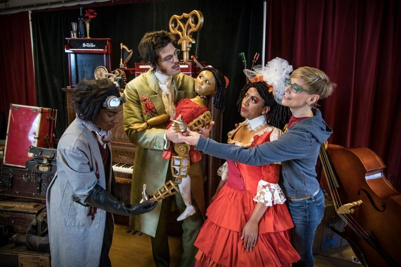 Ariana Douglas (Coppélius), John Kaneklides (Hoffmann), Cecilia Davis (Olympia) and Jill Anna Ponasik (Stage Director) in rehearsal for Skylight Music Theatre's production of The Tales of Hoffmann, March 16-29 on the Cabot Theatre stage.