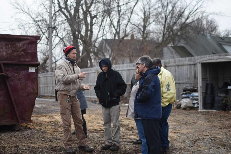 Steve Nicholas (far right) visits Walnut Way's compost site with staff and neighbors during his recent visit.