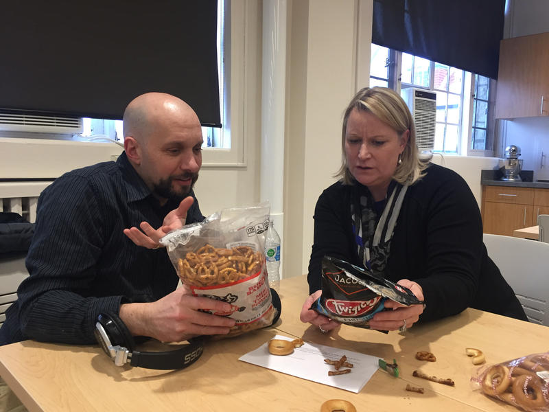 Mitch Teich and food scientist Anne Vravick trying to determine if the snacks they are eating are, in fact, pretzels.