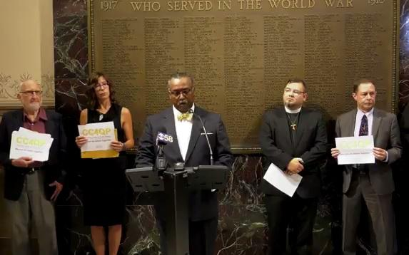 Fred Royal (center) represents CC4QP, calling for Independent Audit of the Milwaukee Police Department in August of 2017.