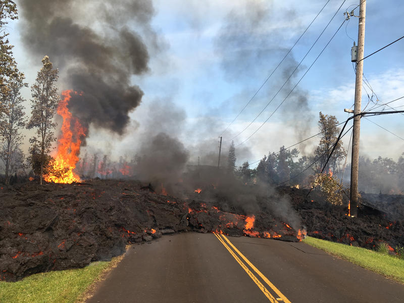 Lava from a fissure slowly advanced to the northeast on Hoʻokāpu Street in Leilani Estates subdivision (May 5, 2018).