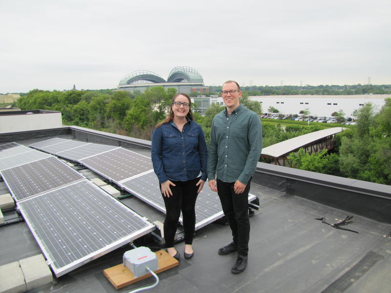 Elizabeth Hittman & Peter Murphy at  rooftop solar installation atop Escuela Verde located above the Menomonee Valley.