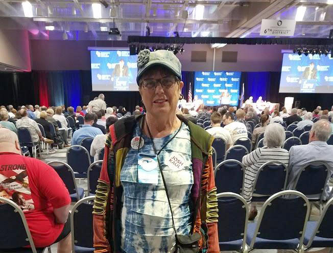 Lee Ann Kingston of Milwaukee stands at the Wisconsin Democratic Convention hall.