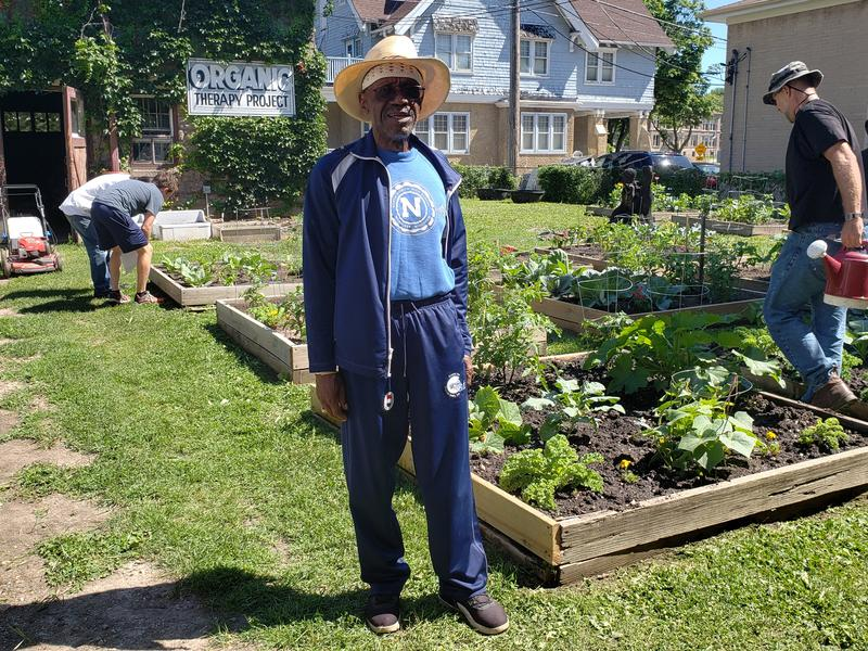 Combat veteran William Sims stands at the Organic Therapy Garden at Vets Place Central.