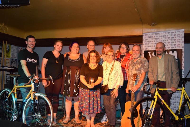 From left to right, back row: Nick Ginster, Wendy Mesich, Nicole Watson, Tom Tolan, Laura Solomon, Jenny Gropp, Denny Rauen & Mitch Teich. Front row: Bonnie North and Anne Kingsbury.