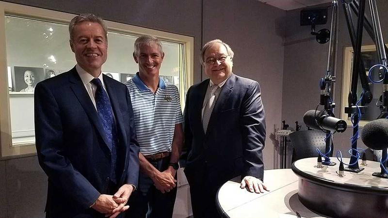 Left to right: UW-Milwaukee Chancellor Mark Mone, Marquette University President Mike Lovell and WUWM's Dave Edwards