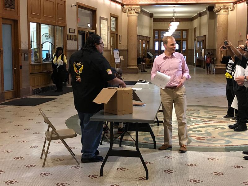 Before Thursday press conference, FLAC's Robert Miranda distributed documents he says bolsters the case that Milwaukee leaders could have acted sooner to protect families from possible lead in water contamination.