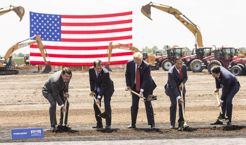 "U.S. President Donald Trump (C) breaks ground with Wisconsin Gov. Scott Walker (2nd L), Foxconn CEO Terry Gou (2nd R), U.S. House Speaker Paul Ryan (R-WI) (R) and Christopher ""Tank"" Murdock (L), the first Wisconsin Foxconn employee."