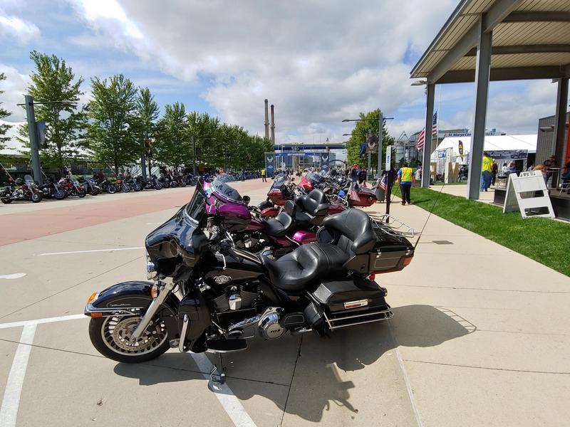 Harley riders park their motorcycles outside the Harley-Davidson Museum.