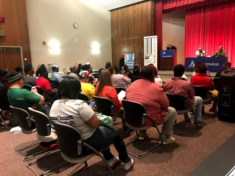 The audience in the auditorium of Ascension St. Joseph Hospital listened intently and recorded moments on their phones from the conversation between Don Black and Masta Ace.