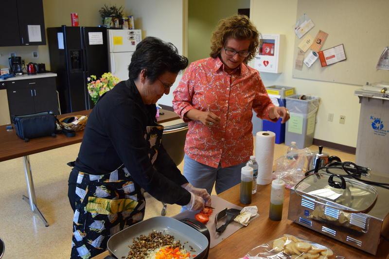 Miriam Vigoa (left) and Kristi Linebaugh making Canary Island Bruschetta in the WUWM station kitchen. (Find the bruschetta recipe toward the end of this story.)