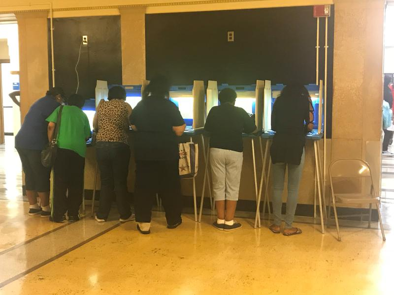 Milwaukee residents vote at Rufus King High School in Tuesday's Wisconsin 2018 partisan primary election.