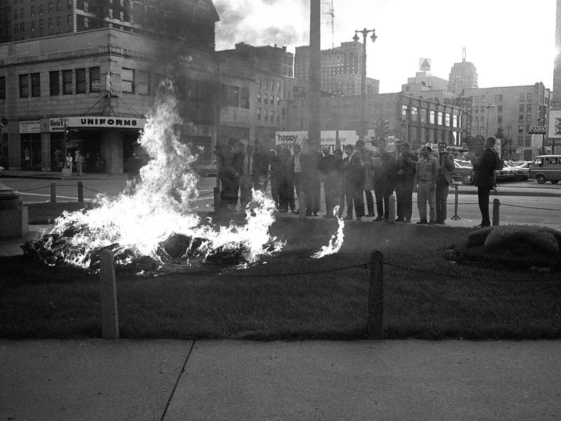 The Milwaukee 14, a group of anti-war activists, watch as the draft cards they took from a Milwaukee government building burn.