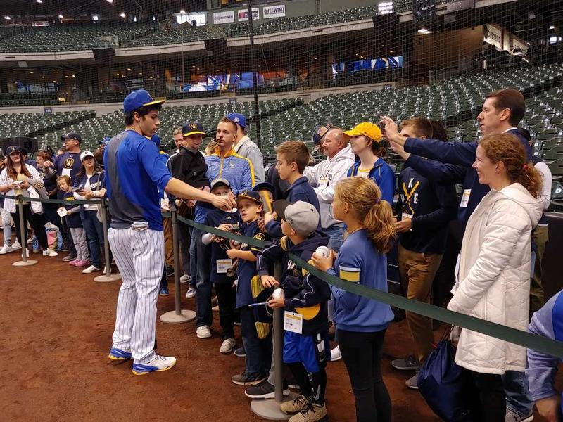 Brewers star outfielder Christian Yelich greets fans before a recent game at Miller Park