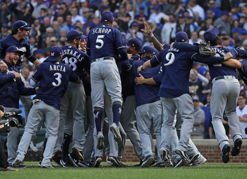 Members of the Milwaukee brewers celebrate after beating the Chicago Cubs in the National League Tiebreaker Game at Wrigley Field on October 1, 2018 in Chicago, Illinois. The Brewers defeated the Cubs 3-1 to win the Central Division.