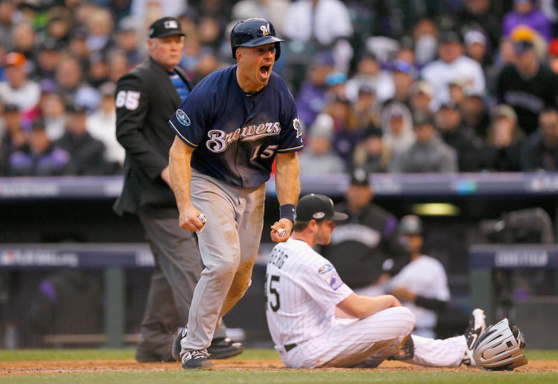 Erik Kratz #15 of the Milwaukee Brewers celebrates scoring on a wild pitch by Scott Oberg #45 who reacts on home plate putting the Brewers up 4-0 in the sixth inning of Game Three of the National League Division Series.