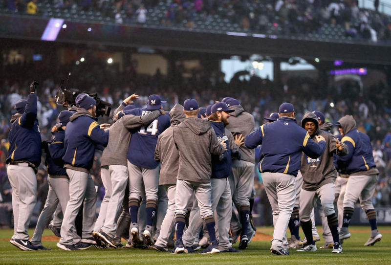 The Milwaukee Brewers celebrate winning Game Three of the National League Division Series by defeating the Colorado Rockies at Coors Field on October 7, 2018 in Denver, Colorado. The Brewers won the game 6-0 and the series 3-0.