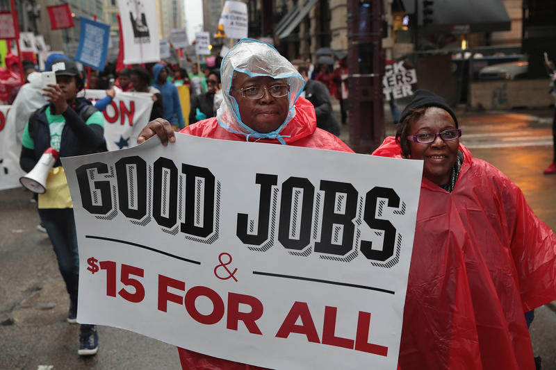 Demonstrators fighting for a $15 per hour minimum wage march through downtown Chicago, Illinois on May 23, 2017.